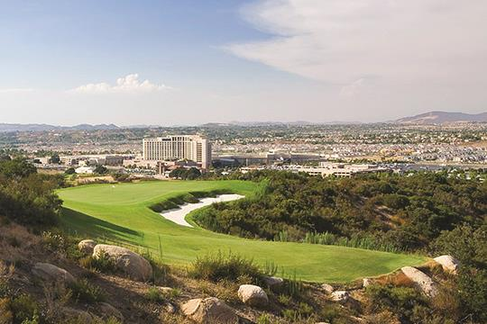 Golf course at our Resort with aerial view of building